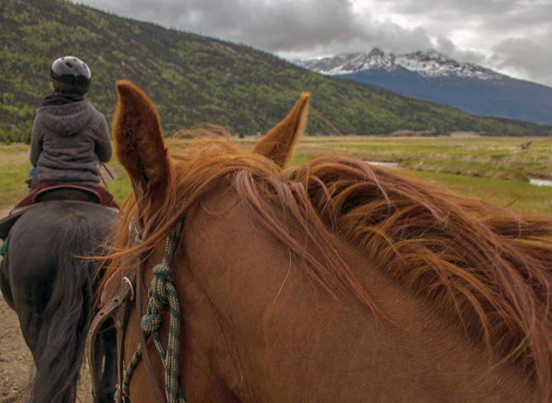 Horseback riders in Alaska.